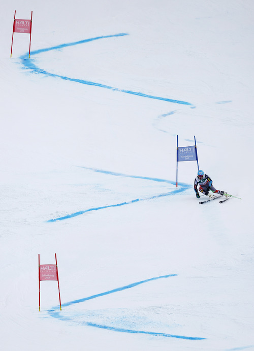 United States's gold medal winner Ted Ligety clears a gate during second run of the men's giant slalom at the Alpine skiing world championships in Schladming, Austria, Friday, Feb.15,2013. (AP Photo/Matthias Schrader)