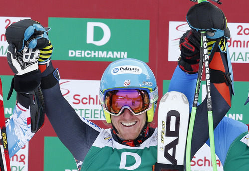 United States's Ted Ligety smiles after winning the gold medal of the men's giant slalom at the Alpine skiing world championships in Schladming, Austria, Friday, Feb.15,2013. (AP Photo/Matthias Schrader)