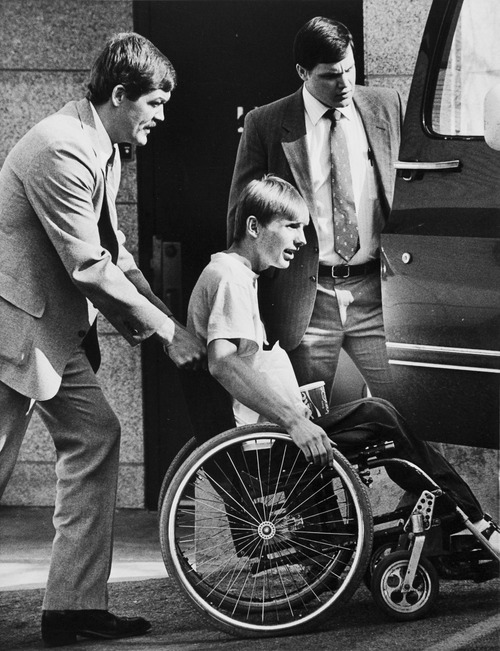 Tribune file photo by Lynn R. Johnson  John Timothy Singer (in wheelchair) leaves court. He was released from prison in 2006 after serving 18 years on federal and state charges of bombing, attempted murder and other offenses. He fired the fatal shot that struck and killed Corrections Officer Lt. Fred House.