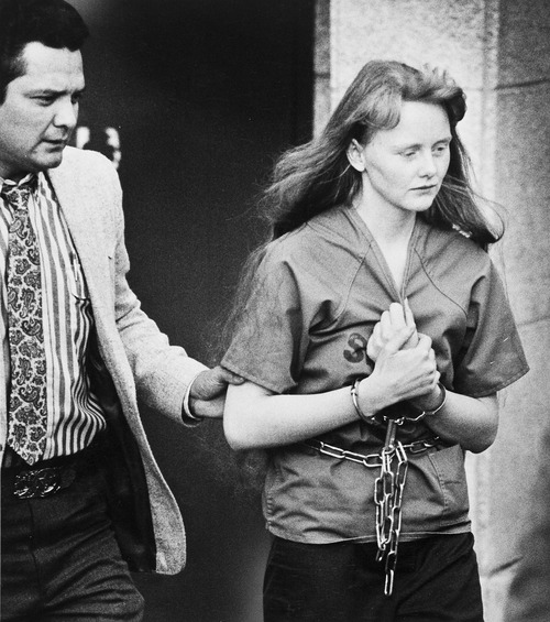 Tribune file photo by Dan Miller  Heidi Singer Swapp is escorted from federal court in 1988 by a U.S. marshal after a magistrate ruled she could be held at a halfway house. Charges against her were later dismissed.