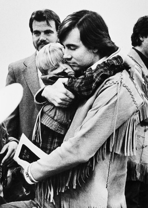 Tribune file photo  Addam Swapp hugs on of his sons during a 1988 court hearing.