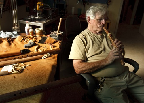 Leah Hogsten  |  The Salt Lake Tribune Bill Hughes plays a flute he made for a veteran out of mountain mahogany. Hughes, who has made about 7,000 Native American-style flutes, six of which were played at the 2002 Olympics, discusses his craft at his studio at Pioneer Craft House on Saturday.
