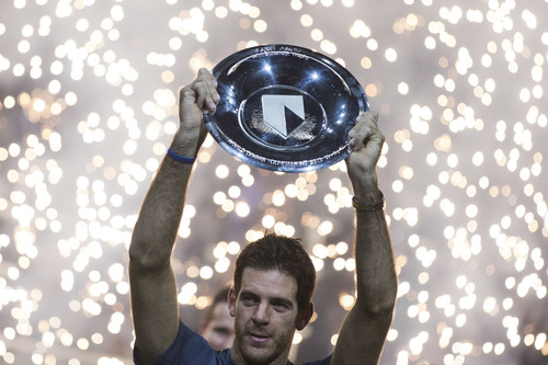 Argentina's Juan Martin del Potro holds the trophy after winning in two sets, 7-6, 6-3, against Julien Benneteau of France in the final of the ABN AMRO world tennis tournament at Ahoy Arena in Rotterdam, Netherlands, Sunday Feb. 17, 2013.  (AP Photo/Peter Dejong)