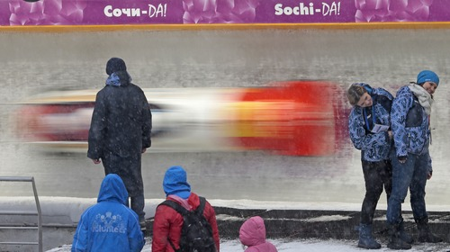 Spectators watch competitions during the 4 men's Bob event at the FIBT Bob & Skeleton World Cup 2013, in Krasnaya Polyana resort, some 60 km east of Sochi, Russia, Sunday, Feb. 17, 2013. (AP Photo/Mikhail Metzel)