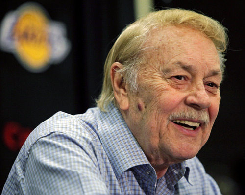 FILE - In this Aug. 17, 2010, file photo, Los Angeles Lakers owner Jerry Buss smiles during an NBA basketball news conference in Bell Gardens, Calif. Buss has been hospitalized with cancer. Team spokesman John Black said Thursday, Feb. 14, 2013, that the team has no plans to comment on Buss' health. (AP Photo/Damian Dovarganes, File)