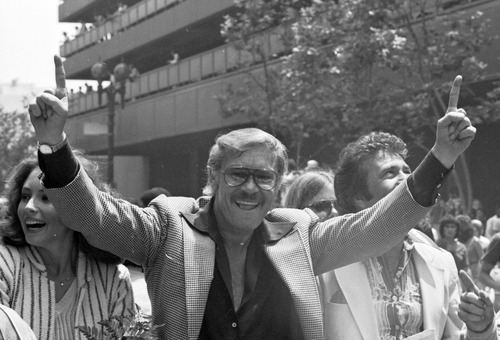 FILE - In this May 19, 1980 file photo, Los Angeles Lakers owner Jerry Buss gestures as the NBA championship team is honored with a parade in Los Angeles. Buss, the Lakers' playboy owner who shepherded the NBA franchise to 10 championships, has died. He was 79. Bob Steiner, an assistant to Buss, confirmed Monday, Feb. 18, 2013  that Buss had died in Los Angeles. Further details were not available. (AP Photo/File)