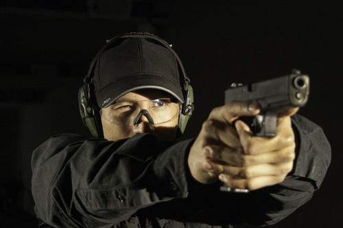 A firearms instructor at F6 Labs in Hicksville, New York, firing a Glock. Courtesy photo
