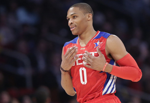 West Team's Russell Westbrook of the Oklahoma City Thunder celebrates against the East Team during the first half of the NBA All-Star basketball game Sunday, Feb. 17, 2013, in Houston. (AP Photo/Eric Gay)