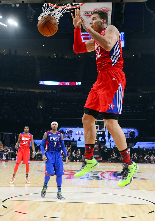 West Team's Blake Griffin of the Los Angeles Clippers goes hop for a shot during the first half of the NBA All-Star basketball game Sunday, Feb. 17, 2013, in Houston. (AP Photo/Bob Donnan, Pool)