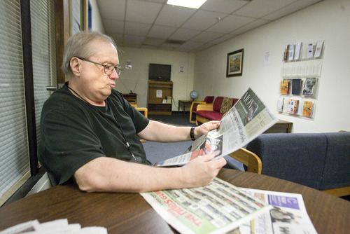 Paul Fraughton  |  The Salt Lake Tribune Kevin Moody reads the newspaper Friday in the day room at the Bonneville Community Correctional Center. Moody has found employment and will soon be leaving the facility.