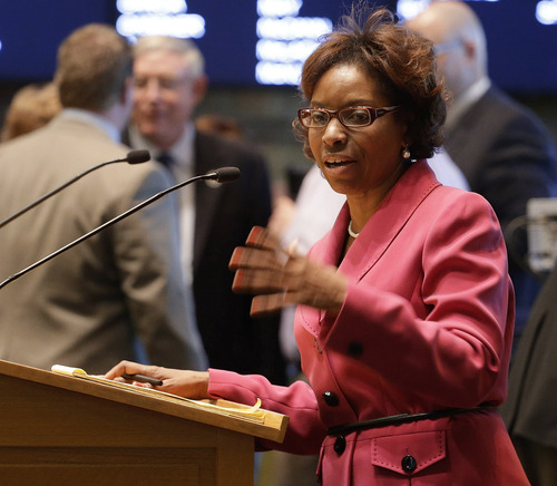 Rep. Rhonda Fields, D-Aurora,  urges House members to pass her bill on limiting the size of ammunition  magazines at the Capitol in Denver on Friday, Feb. 15, 2013. Kicking off a long, emotional debate about guns, Colorado lawmakers clashed Friday over setting limits on the size of ammunition magazines, a proposal in a package of Democratic bills responding to mass shootings at a suburban Denver movie theater and a Connecticut elementary school.(AP Photo/Ed Andrieski)