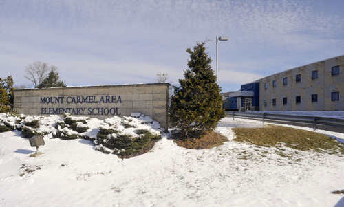 """In this Feb. 10, 2013 photo, shown is the Mount Carmel Area Elementary School in Mount Carmel, Pa.  Kelly Guarna's 5-year-old daughter Madison was suspended from school for making a """"terroristic threat"""" last month after her mother said she talked about shooting a Hello Kitty bubble gun. (AP Photo/Jimmy May)"""