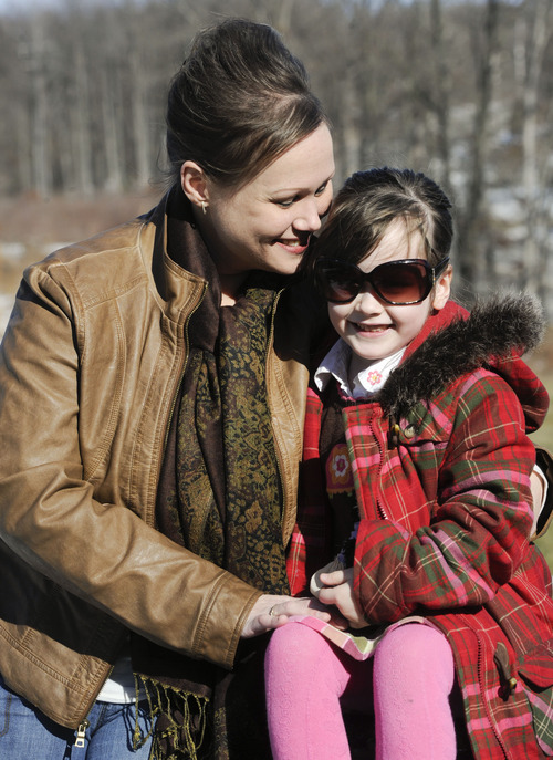"""In this Feb. 10, 2013 photo, Kelly Guarna and her 5-year-old daughter Madison pose for a portrait in Mount Carmel, Pa. The kindergartener was suspended from school for making a """"terroristic threat"""" last month after her mother said she talked about shooting a Hello Kitty bubble gun. (AP Photo/Jimmy May)"""