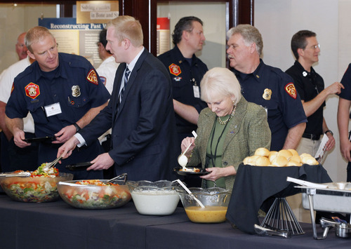 Al Hartmann  |  The Salt Lake Tribune Sen. Karen Mayne, D-West Valley City, right, has a lunch buffet with members of the Salt Lake Unified Fire Department at the Utah Fire Caucus Luncheon on Monday February 11, 2013.  It's an opportunity for fire department officials from around the state to have conversation and lunch with lawmakers.