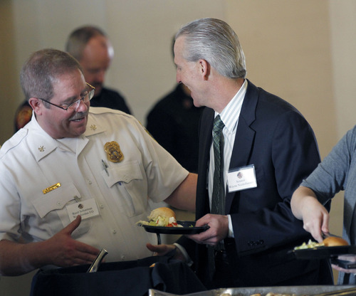 Al Hartmann  |  The Salt Lake Tribune Reed Sherman with the West Jordan Fire Department, left, shakes hands with Senate President Wayne Niederhauser, R-Sandy, as they make their way through a lunch buffet at the Utah Fire Caucus Luncheon on Monday, Feb. 11, 2013.