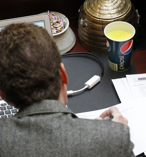 Al Hartmann  |  The Salt Lake Tribune A legislator in the Utah House of Representative works away Monday, Feb. 11, 2013, with a soft drink close at hand, compliments of the Utah Beverage Association. Behind the House chambers are free soft-drink dispensers.