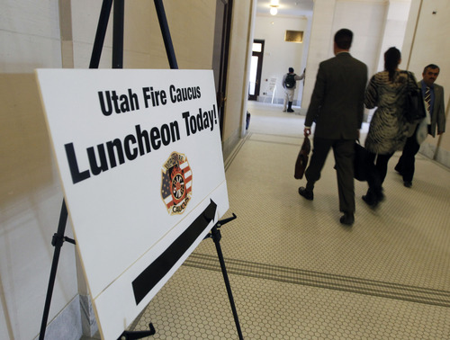 Al Hartmann  |  The Salt Lake Tribune Sign directs legislators to the Utah Fire Caucus Luncheon on Monday, Feb. 11, 2013. It's an opportunity for fire officials from around the state to have conversation and lunch with their individual representatives.