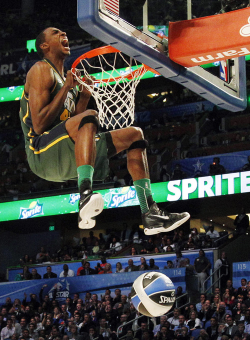 Utah Jazz's Jeremy Evans hangs onto the rim after his attempt during the NBA basketball All-Star Slam Dunk Contest in Orlando, Fla., Saturday, Feb. 25, 2012. Evans earned 29 percent of 3 million text message votes cast by fans to win the competition. (AP Photo/Lynne Sladky)