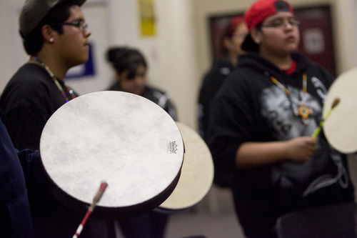 Kim Raff  |  The Salt Lake Tribune Drummers perform during a Round Dance, organized by members of the Ute Indian Tribe, at Uinta River High School in Fort Duchesne on February 9, 2013.