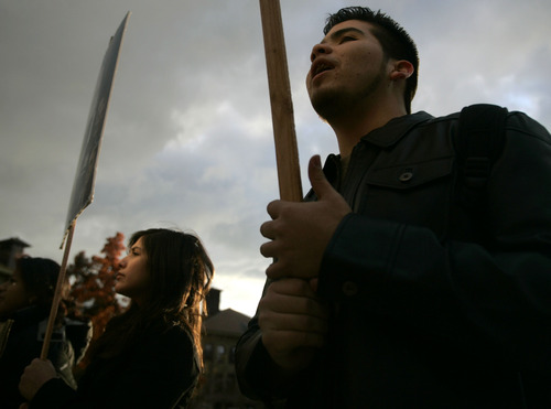 Jim Urquhart | The Salt Lake Tribune Lily Matinez of West Jordan, left, and Richard Diaz of West Valley City, both students at the Univeristy of Utah, chant during a protest organized by the Coalition of American Indian Students on Dec. 4,2008.  Students questioned the school's commitment to American Indian educational equity, citing as evidence the U.'s relinquishment last year of $2.1 million in federal funds for American Indian teacher education programs.