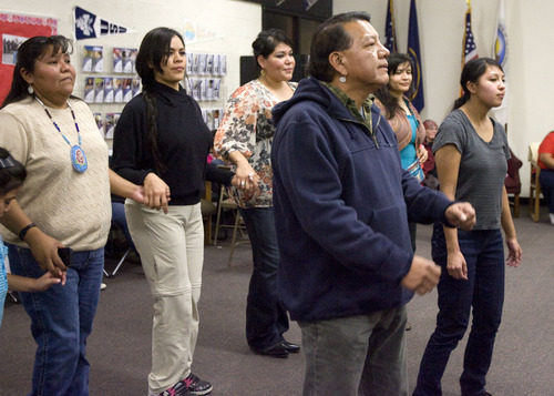 Kim Raff  |  The Salt Lake Tribune Larry Cesspooch dances as drummers perform and sing during a Round Dance, organized by members of the Ute Indian Tribe, at Uinta River High School in Fort Duchesne on February 9, 2013.
