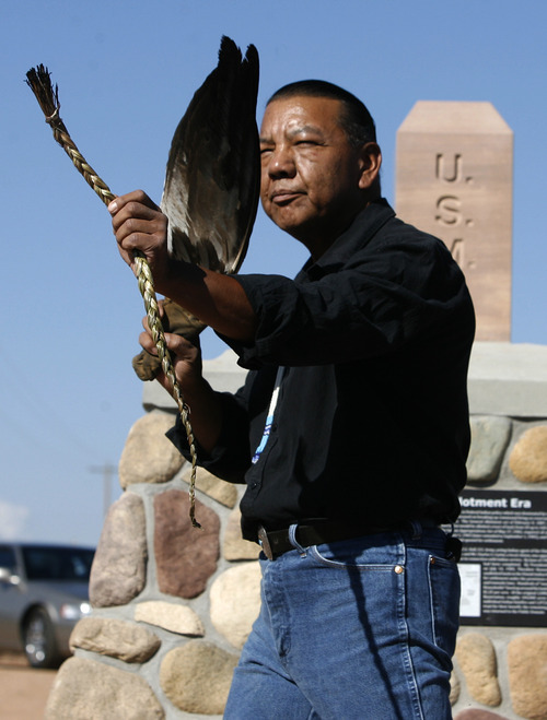 Rick Egan | The Salt Lake Tribune Larry Cesspooch holds an eagle feather and a strand of sweet grass as he says  a prayer at the the dedication of a historical marker in 2009.  Cesspooch, a Ute, educates about what the symbols represent to Native Americans.