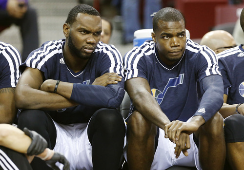 Utah Jazz's Al Jefferson, left, and Paul Milsap watch the closing minutes of their NBA basketball game against the Sacramento Kings in Sacramento, Calif., Saturday, Feb. 9, 2013. The Kings won 120-109. (AP Photo/Rich Pedroncelli)