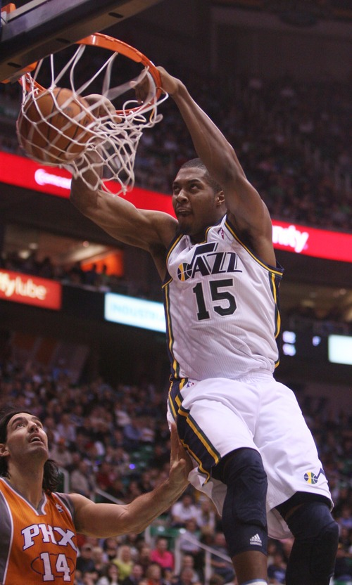 Kim Raff  |  The Salt Lake Tribune Utah Jazz power forward Derrick Favors (15) dunks the ball during the second half against the Phoenix Suns at EnergySolutions Arena in Salt Lake City, Utah on November 10, 2012. The Jazz went on to win the game 94-81.