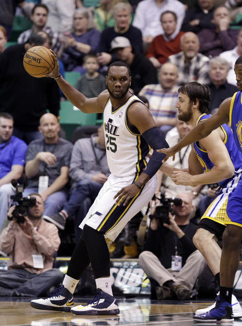 Golden State Warriors' Andrew Bogut, right, defends against Utah Jazz's Al Jefferson (25) in the first quarter during an NBA basketball game Tuesday, Feb. 19, 2013, in Salt Lake City. (AP Photo/Rick Bowmer)
