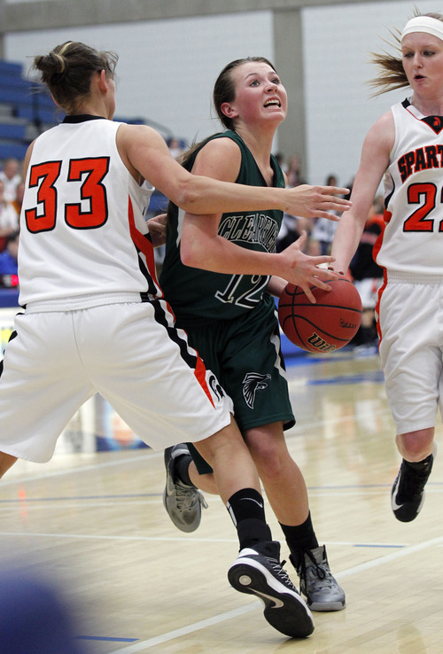 Al Hartmann     The Salt Lake Tribune Clearfield High School's  Bailey Douglas, center, runs into touogh defense against Murray High School's Lauren Bell, left, and Brooke Barker during a Girl's 4A play off game at Salt Lake Community College Tuesday, February 19.