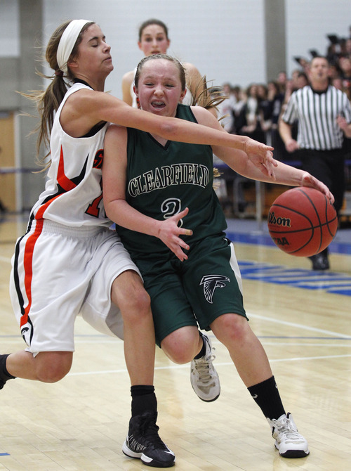 Al Hartmann     The Salt Lake Tribune Murray High School's Christal Milne reaches over to try for a steal on the run against Clearfield Tayley Stoddart during a Girl's 4A play off game at Salt Lake Community College Tuesday, February 19.