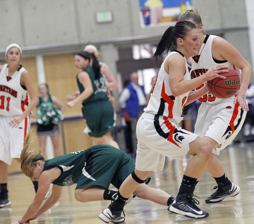 Al Hartmann     The Salt Lake Tribune Murray  High School's Jordan Strah makes a steal from Murray High School'sTasia Timms during a Girl's 4A play off game at Salt Lake Community College Tuesday, February 19.