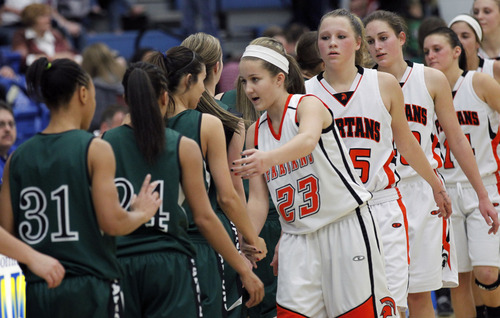 Al Hartmann     The Salt Lake Tribune Clearfield High School shakes hands with players from Murray High School players during a Girl's 4A play off game at Salt Lake Community College Tuesday, February 19.  Clearfield won the matchup.