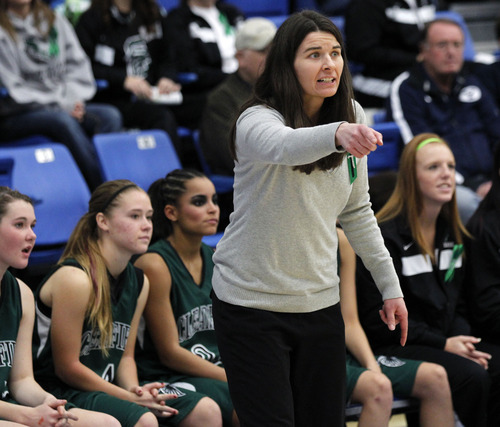 Al Hartmann     The Salt Lake Tribune Clearfield High School coach Rebecca Parker calls plays to her team against  Murray High School during a Girl's 4A play off game at Salt Lake Community College Tuesday, February 19.