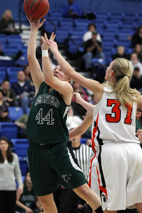 Al Hartmann     The Salt Lake Tribune Clearfield High School's Kaitlyn Stratton puts up a shot over Murray High School's Lexi Davies during a Girl's 4A play off game at Salt Lake Community College Tuesday, February 19.