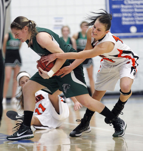 Al Hartmann     The Salt Lake Tribune Clearfield High School's Kaitlyn Stratton strips the ball from Murray High School's Jordan Strah as she brings ball upcourt during a Girl's 4A play off game at Salt Lake Community College Tuesday, February 19.