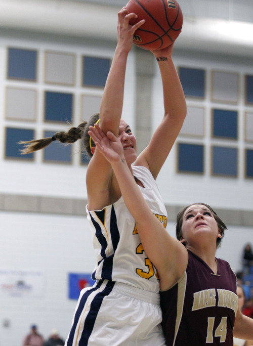 Al Hartmann     The Salt Lake Tribune Bonneville High School's Sam Filiaga goes up high to tear down a rebound over Maple Mountain High School's Katie Muhlestein during a Girl's 4A play off game at Salt Lake Community College Tuesday February 19.