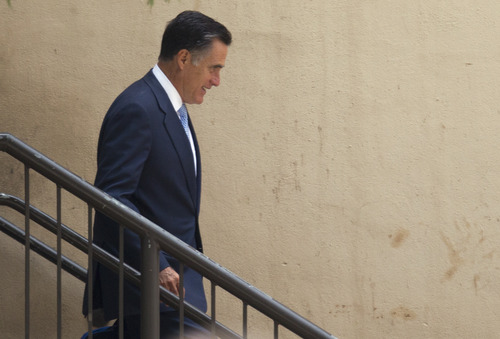 Republican presidential candidate, former Massachusetts Gov. Mitt Romney leaves a fundraiser that included Gov. Bobby Jindal, R-La., on Monday, July 16, 2012 in Baton Rouge, La.  (AP Photo/Evan Vucci)