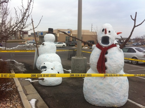 South Jordan police have been displaying four synthetic snowmen, on loan from the Utah Highway Patrol, outside a Harmon's at 11453 S. Parkway Plaza Drive to raise awareness about drunk driving. Police suspect thieves made off with the one wearing a red scarf sometime between Saturday afternoon and Sunday morning. Courtesy South Jordan Police Officer Samuel Winkler