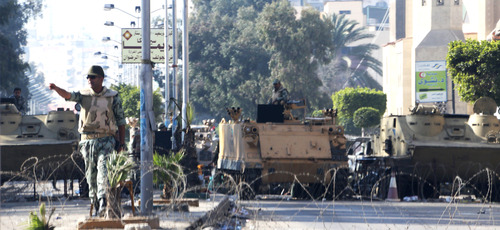In this Monday, Jan. 28, 2013 photo, a state of emergency is imposed in Port Said, Egypt. President Mohammed Morsi declared a curfew in three provinces along Suez Canal to prevent the current unrest. Egypt's powerful military is showing signs of growing impatience with the country's Islamist leaders, criticizing their policies and issuing veiled threats that it might seize power again. The tension is raising the specter of a military intervention much like the one in 2011, when generals ousted Hosni Mubarak to end a popular uprising.(AP Photo/The Yomiuri Shimbun) JAPAN OUT