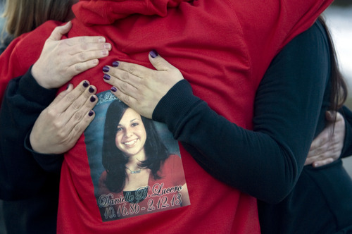 Kim Raff  |  The Salt Lake Tribune Mary Beltran, left, her daughter Lachele Beltran, who are neighbors of Danielle Lucero, comfort Lucero's brother Andrew Lucero, who is wearing a sweatshirt with his sister's picture on it, during a candlelight vigil Sunday at the Midvale home where Lucero, Omar Jarman and Shontay Young were slain.