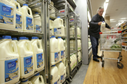 Sergio Dionisio/Bloomberg Under the pared-down odinance, grocery stores won't be charged an extra fee based on the gallons of milk in the store.