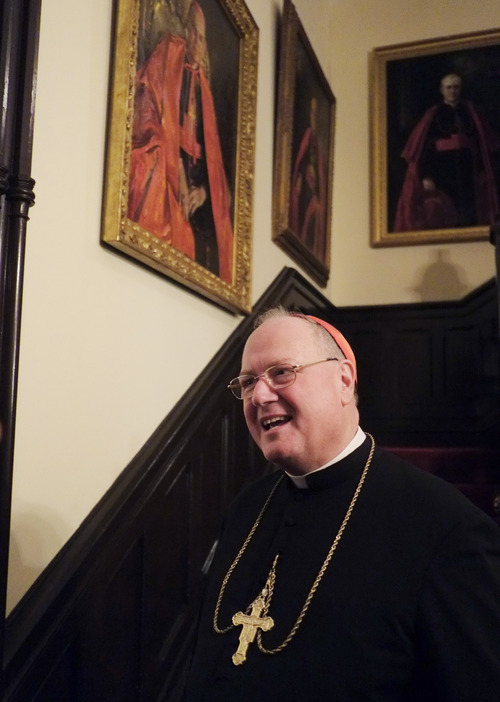 New York Cardinal Timothy Dolan speaks to the press in his residence, Monday, Feb. 11, 2013. Dolan says he was as startled as the rest of the world about Pope Benedict XVI's announcement that he will resign later this month due to failing health. (AP Photo/Mark Lennihan)