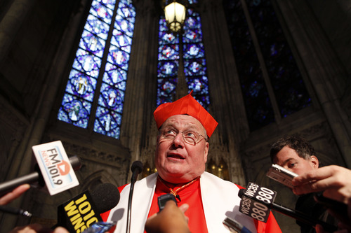 Cardinal Timothy Dolan speaks to the press after leading a morning prayer service at St. Patrick's Cathedral, Saturday, Feb. 25, 2012 in New York. (AP Photo/Jason DeCrow)