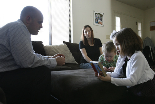 Scott Sommerdorf   |  The Salt Lake Tribune Matt and Kylee Duff listen as Mikelle, 7, and Jonah, 5, read as they get their children ready for church, Sunday, Feb. 3, 2013. The Duffs were married in the Salt Lake LDS Temple and living happy, Mormon lives until about this time last year, when Matt began to question his faith.