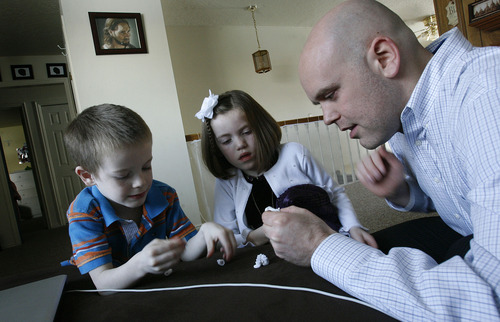 Scott Sommerdorf   |  The Salt Lake Tribune Matt Duff plays with Jonah, 5, and Mikelle, 7, as the children get ready for church, Sunday, Feb. 3, 2013. The Duffs were married in the Salt Lake LDS Temple and living happy, Mormon lives until about this time last year, when Matt began to question his faith.