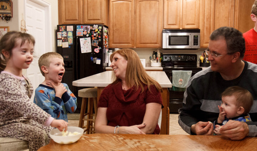 Trent Nelson  |  The Salt Lake Tribune Myndee and Randy Garrett, at home with their children Wednesday, Feb. 6, 2013 in Herriman. Left to right, Emma, Logan, Myndee, Randy and RJ.