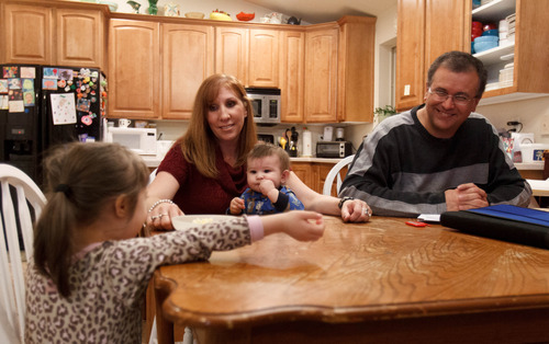 Trent Nelson     The Salt Lake Tribune Myndee and Randy Garrett, at home with their children Wednesday, February 6, 2013 in Herriman. Left to right, Emma, Myndee, RJ and Randy.