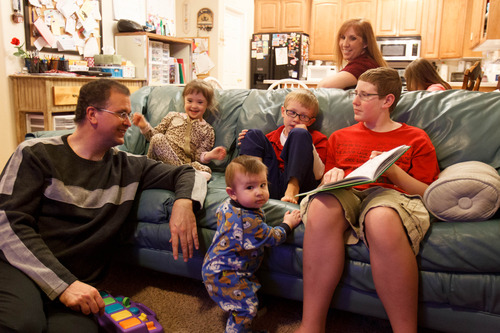 Trent Nelson  |  The Salt Lake Tribune Myndee and Randy Garrett, at home with their children Wednesday, February 6, 2013 in Herriman.