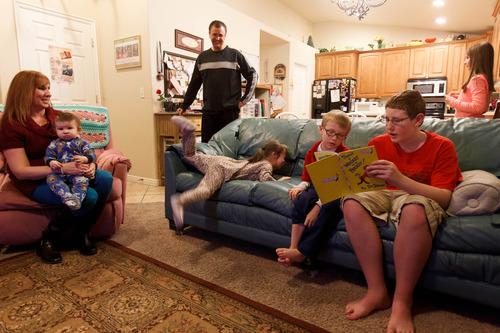 Trent Nelson     The Salt Lake Tribune Myndee and Randy Garrett, at home with their children Wednesday, February 6, 2013 in Herriman.